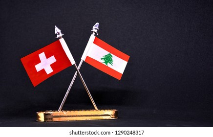 Switzerland and Lebanon table flag with black Background