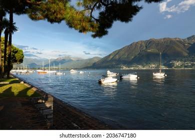 Switzerland, Locarno, 31 Aug 20. Sunset with sail boat on the lago maggiore lake