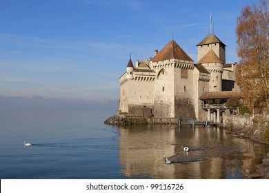 Switzerland, Montreux. Chillon Castle located on the shores of Lake Geneva (at dawn).