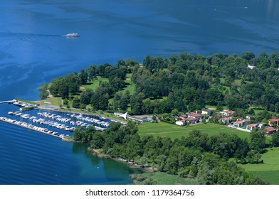 Switzerland: Paragliding above Lago Maggiore Delta with view to the yacht harbour in Ascona