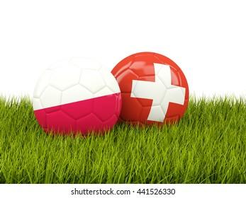 Switzerland and Poland soccer balls on grass. 3D illustration