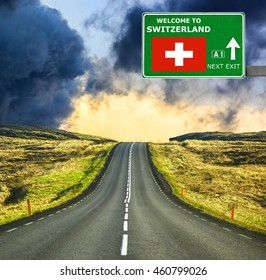 Switzerland road sign against clear blue sky