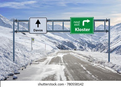 switzerland ski town Kloster and Davos road big sign with a lot of snow and mountain sky