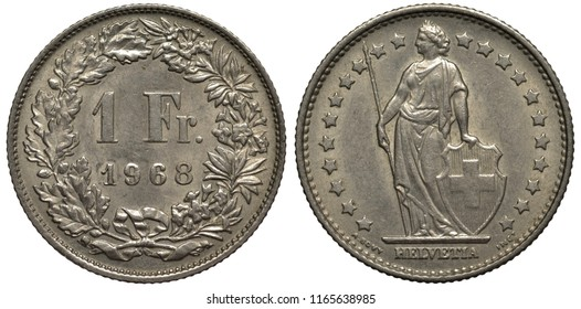 Switzerland Swiss coin 1 one franc 1968, denomination and date within circular wreath, woman in toga  holding spear and shield with cross surrounded by stars,