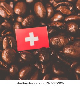a Switzerland, Swiss flag placed over roasted coffee beans