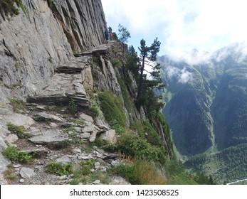 Switzerland, Tour du Mont Blanc - on the route from the Col de la Forclaz pass to the Col de Balme, view with climbing tourists