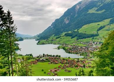 Switzerland.The village near mountain lake