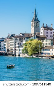 SWITZERLAND, ZURICH - AUGUST 22: view of historic Zurich city center with famous St. Peter and Fraumunster churches, Limmat river and Zurich lake on August 22, 2015