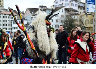 SWITZERLAND, ZURICH - MARCH 5, 2017: Participants in costumes perform a street procession of ZueriCarneval Fasnacht.