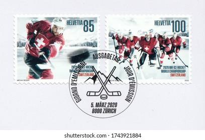 SWITZERLAND-CIRCA 2020:A stamp printed in Switzerland,shows Hockey players of the national team. Ice hockey world championship, circa 2020