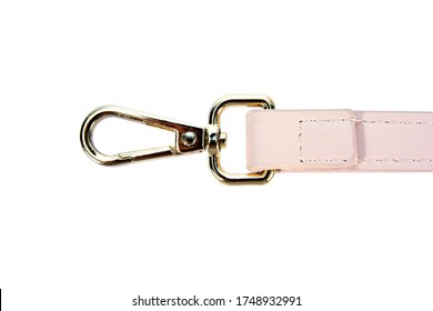 Swivel lobster clasp snap hook clip with leather shoulder bag strap isolated on white background. Metal swivel clip snap hook or gold trigger webbing bag hook isolated