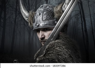 Sword, Viking warrior with helmet over vintage textured background