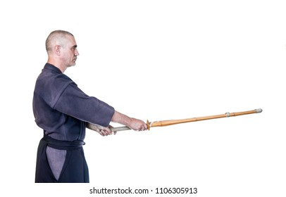 swordsman in attacking position 'kamae' with bamboo sword 'sinai'  for Japanese fencing Kendo training