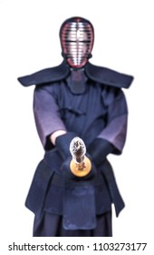 swordsman in attacking position and protective equipment 'bogu' and bamboo sword 'sinai'  for Japanese fencing Kendo training