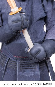 swordsman in attacking position and protective equipment 'bogu' and bamboo sword 'sinai'  for Japanese fencing Kendo training close-up
