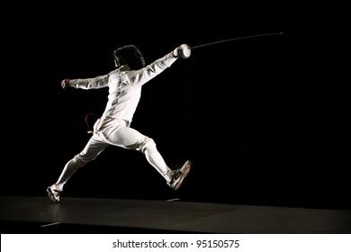 swordsman isolated on black background