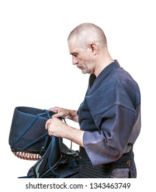 swordsman wearing  protective equipment for head 'men' for Japanese fencing Kendo training close up
