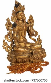 The Syama Tara (Green Tara) statuette with amber beads isolated on the white background