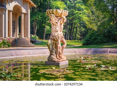SYCHROV, CZECH REPUBLIC - AUGUST 8, 2015: Garden Pond and Small Statue near Orangerie. Sychrov Castle can be found near the village Sychrov in the Liberec Region of the Czech Republic.