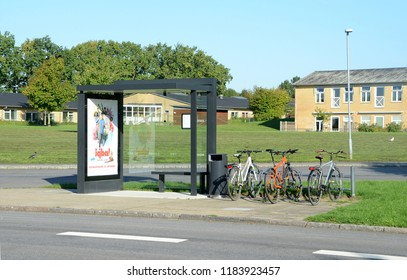 Sydals, Denmark - September 18, 2018: BUs stop in suburban area with parked bicycles and movie poster