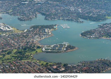 Sydney aerial view with Concord, Cabarita, Galdsville, Tennyson Point and Abbotsford suburbs. Sydney birds eye view of residential districts, neighborhoods with harbor view. Sydney Australia