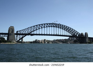 SYDNEY - APRIL 9 2012: View of Sydney and the Harbour Bridge on April 9, 2012 in Sydney, Australia. Many tourists visit Sydney every year, making it one of the top tourist destinations.