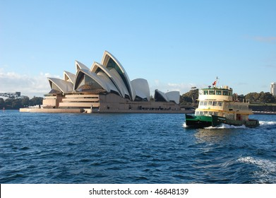 SYDNEY - AUGUST 18: Ferry passes by Sydney Opera House on a sunny day of August 18, 2008 in Sydney, Australia.