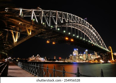 SYDNEY - August 19: The lights of the Sydney Opera House and the downtown Sydney skyline shine under the Sydney Harbour Bridge at night on August 19, 2010 in Sydney, New South Wales, Australia.
