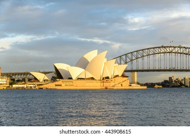 SYDNEY - AUGUST 31, 2014: Opera House and Harbour Bridge at sunset