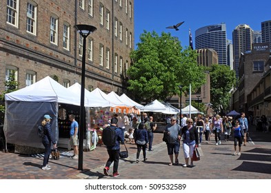 SYDNEY, AUS  - OCT 23 2016: Visitors at The Rocks markets. It is a major tourist attraction weekend market in Sydney, Australia.