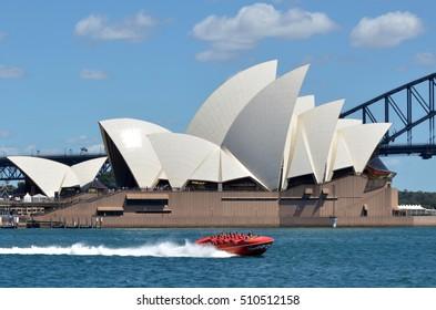 SYDNEY, AUS  - OCT 23 2016: Sydney Harbour Jet Speed Boats sail under Sydney Opera House and Sydney Harbour Bridge in  Sydney, New South Wales, Australia.