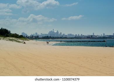 SYDNEY, AUSTRAIA, 5TH APRIL 2018 - Ramsgate Beach in Botany Bay, Sydney, New South Wales, Australia, with Sydney city skyline in the distance