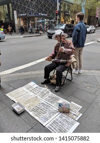 sydney, Australia 06 01 2019: old Asian man busking for money on shopping district Pitt st, playing traditional Chinese musical instrument erhu