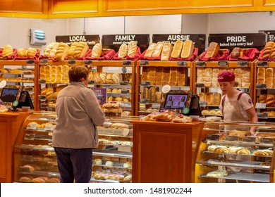 Sydney / Australia 08-10-2019: Exterior view of Bakers Delight bakery - a part of large Australian-owned bakery franchise chain with over 700 local outlets. Customer buying bread at local bakery