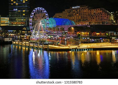 SYDNEY, AUSTRALIA -13 JUL 2018- Night view of the Star of the Show Ferris Wheel in Darling Harbour, a busy modern neighborhood in Sydney, New South Wales.