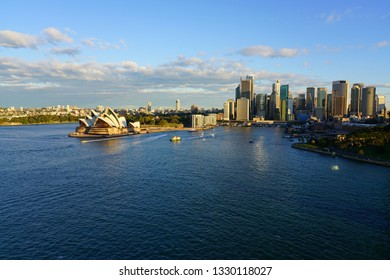 SYDNEY, AUSTRALIA -13 JUL 2018- View of the Sydney Opera seen from the Sydney Harbour Bridge at sunset in the Sydney Harbour in New South Wales, Australia.