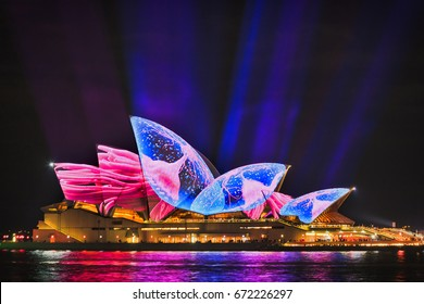 Sydney, Australia - 14 June 2017: Sydney opera house brightly painted as jellyfish and octopus by light beams projections during Vivid Sydney 2017 light show.