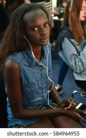 SYDNEY / AUSTRALIA - 20 May: Model listens to music while getting ready for show before House of Cannon fashiob show at Mercedes Benz Fashion Week Australia on 20 May 2016 in Carriageworks Sydney