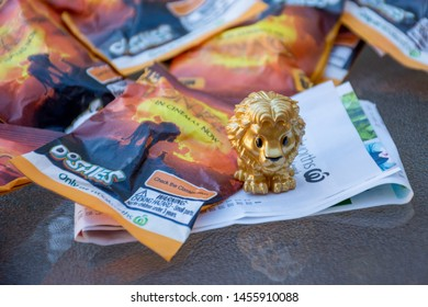Sydney / Australia 20-07-2019 Lion King Woolworths supermarket promotion faces a plastic waste petition. Golden Mufasa and a lot of promotion packaging