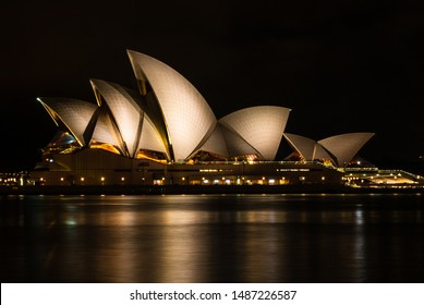 Sydney, Australia - 2019. A nightscape of illuminated Sydney opera house when sky is getting dark and lights are getting brighter.