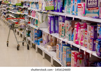 Sydney / Australia 2019-19-07 A shopping trolley standing alone in baby aisle at Coles Supermarket