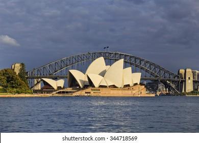 SYDNEY, AUSTRALIA, 22 NOVEMBE 2015 - Sydney opera house and Harbour bridge in Sydney at sunrise. Iconic and world famous landmark of Australia viewed from Mrs Macquary point in Royal Botanic Garden