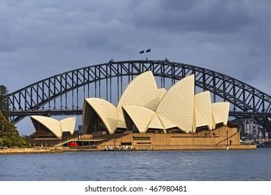 SYDNEY, AUSTRALIA, 22 NOVEMBER 2015 - Sydney opera house and Harbour bridge in Sydney at sunrise. Iconic and world famous landmarks of Australia viewed from Mrs Macquary point in Royal Botanic Garden