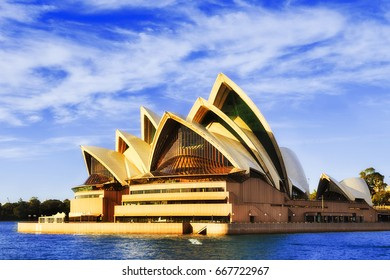 Sydney, Australia - 24 June 2017: Facade of modern contemporary  Opera House theater building on Sydney city harbour waterfront on a bright sunny day.