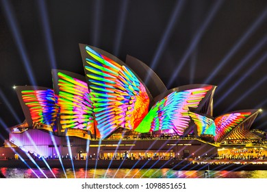 Sydney, Australia - 25 May, 2018: Sydney city landmark of Sydney Opera House at harbour waterfront during annual light show of music, light and ideas painted by light in bird wings motive.