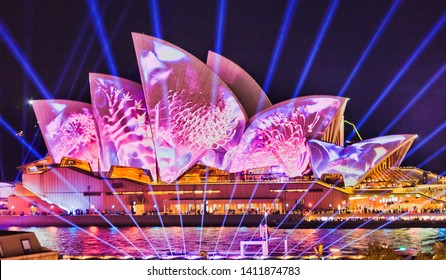 Sydney, Australia - 25 May 2019: Colourful image of chrysanthemum flowers projected on side of Sydney Opera house during Vivid Sydney ligh show festival.