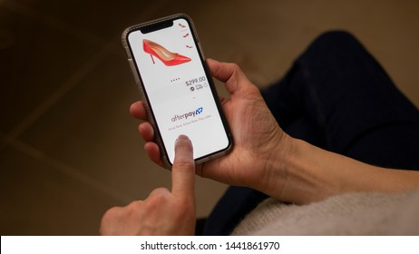 Sydney, Australia - 4 July, 2019: Woman shopping online on a mobile, utilising Afterpay to pay for purchases. Afterpay is a buy now pay later service provider, founded in Australia.
