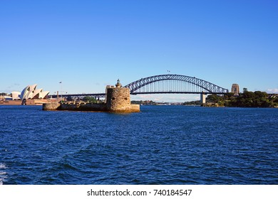 SYDNEY, AUSTRALIA -5 AUG 2017- Panoramic view of the Sydney harbor, including the iconic opera house and Sydney Harbour Bridge, in Australia under a blue sky.