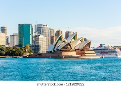 Sydney, Australia - 5th June 2015: The cruise ship Carnival Spirit moored next to the Opera House. Sydney is a popular cruise destination.