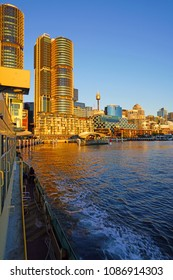 SYDNEY, AUSTRALIA -6 AUG 2017- Sunset view of Darling Harbour, a busy modern neighborhood in Sydney, New South Wales.